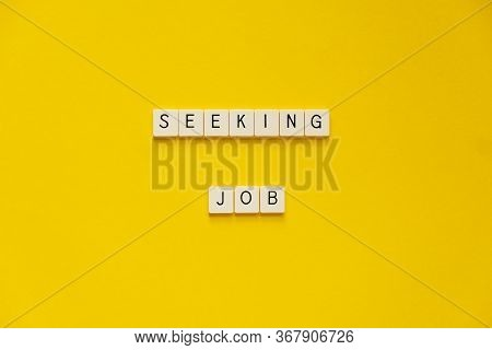 Phrase Seeking Job. Blocks With Letters On A Yellow Background. The Concept Of Job Search During The