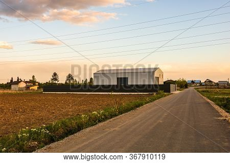 Big Metal Industrial Storage Shed Building.  Exterior Of Warehouse, No Brands On Storehouse With Cop