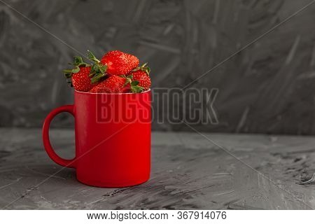 Ripe Red Strawberries. Bowl Filled With Juicy Fresh Ripe Red Strawberries. Strawberries On A Grey Co