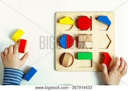 Educational Toys, Cognitive Skills, Montessori Activity. Closeup: Hands Of A Little Montessori Kid L