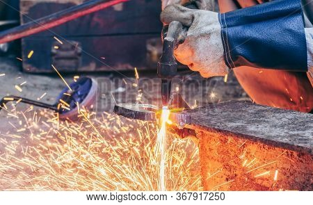 Close Up Hand Heavy Industrial Worker Is Working On Metal Work Factory Process By Cutting Sheet Stee