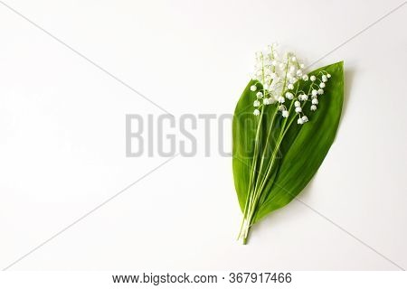 Lily Of The Valley, May Bells Flowers And Green Leaves Flat Lay Isolated On White Background Top Vie