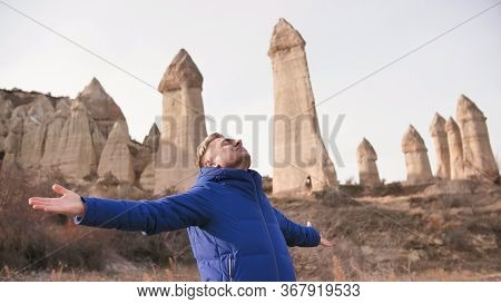 Russian Tourist Energized In The Valley Of Love In Goreme Cappadocia Turkey During The Freezing Wint
