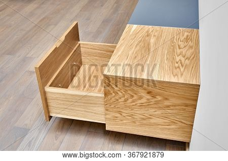 Floating Media Cabinet In Contemporary Living Room. Wall Mounted Wooden Cabinet With Open Drawers