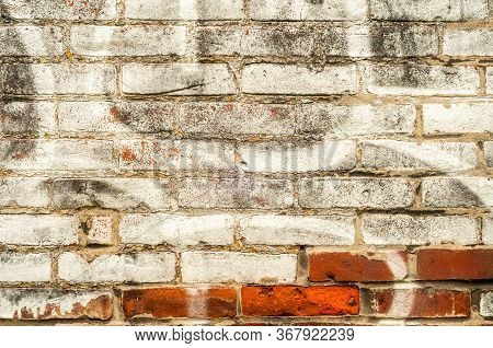 A Partially White-washed Brick Wall With Paint Swirls Forms An Interesting Urban Design, Good For Ba