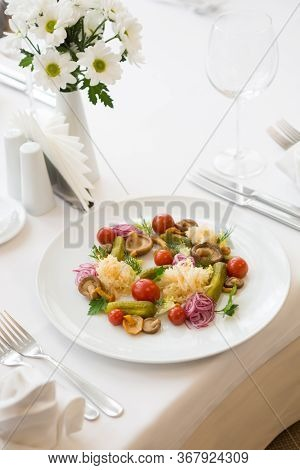 Marinated Vegetables And Mushrooms Served On A Plate