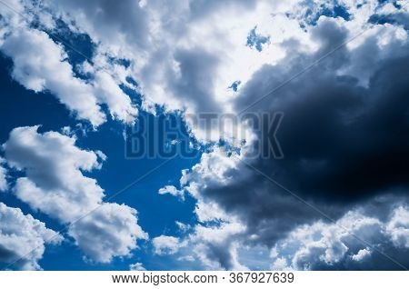 Dramatic blue sky background, thundery sky landscape scene. Colorful cloudy sky view in bright tones. Dramatic sky background, cloudy sky landscape, sunny sky view