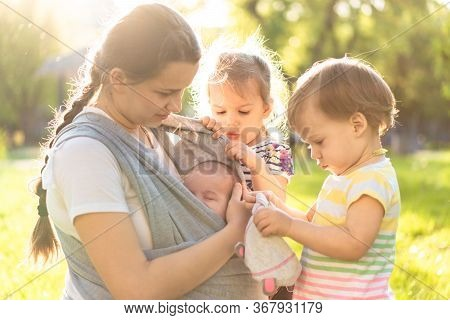 Motherhood, Care, Infants, Summer, Childhood And Large Families Concept - Young Beautiful Mom With N