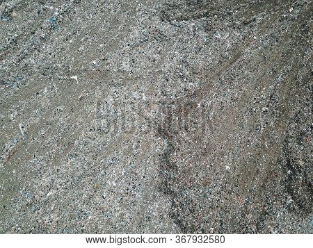 Aerial View Of City Dump. A Huge Garbage Dump. Birds Circling Over The Garbage