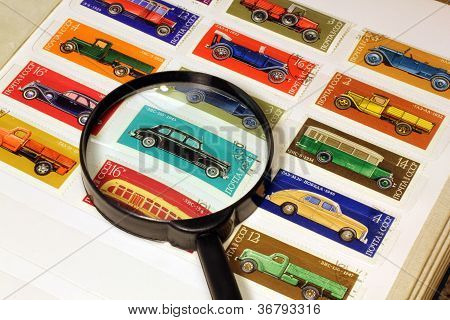 Stamps In An Album And Magnifying Glass