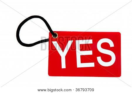 Red Paper Tag Labeled With Yes Words