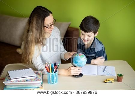 Remote Education, Homeschooling Concept. Boy With Mother Doing Homework During The Quarantine.