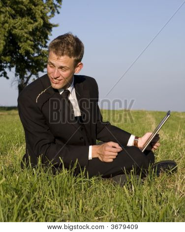 Young Business Man Working In The Park