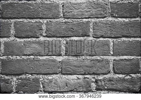 Seamless Dark Grey Brick Wall Texture Background. Pattern Of Weathered Old Cracked Brickwall. Stacke