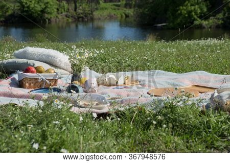 Hike Picnic. Picnic Concept. Youth Having Fun Picnic In River