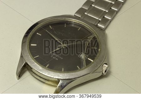 Broken Wrist Watch, With Its Glass Shattered And Damaged Bracelet