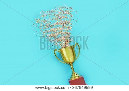Image Of Little Gold Cup , Concept For Winning Or Success. Golden Trophy Cup And Streamers On Blue B