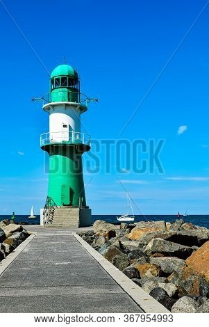 Lighthouse On The Western Pier In Warnemunde In Germany