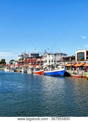 Warnemünde, Germany - July 14, 2017: Small Fishing Boats Lie In The Fishing Port