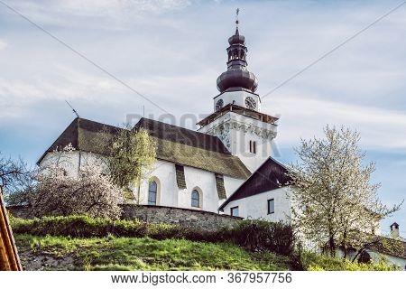 Parish Church Of Saint John The Evangelist In Banska Bela Village, Slovak Republic. Religious Archit