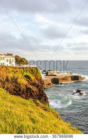 Cliffs By The Atlantic Ocean In Fishermans Village Lagoa, Sao Miguel Island, Azores, Portugal. Tradi