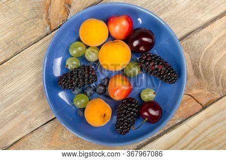 Various Summer Fresh Berries In A Bowl On Rustic Wooden Table. .antioxidants, Detox Diet, Organic Fr