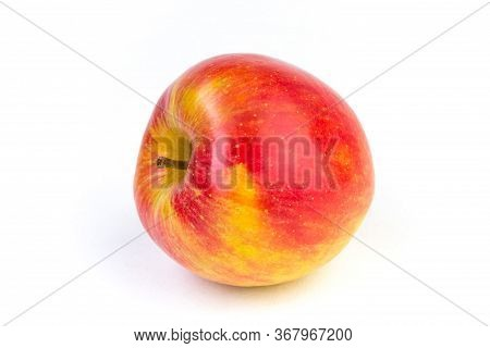A Juicy Red With Yellow Apple On A White Background.