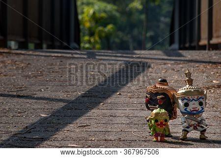 Ravana, Giantess And Hanuman Walking On The Bridge In The Park. Traveller Doll.