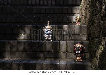 Ravana, Giantess And Hanuman. Standing On A Stone Stairway With Light Shining Down. Traveller Doll.