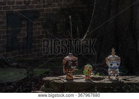 Ravana, Giantess And Hanuman Standing On A Stone Fence Around A Large Tree In The Cemetery. Travelle