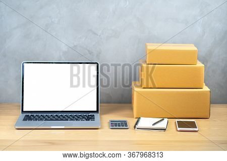 Wooden Table Workspace Office At Home With Laptop Computer, White Screen Notebook With Calculator An