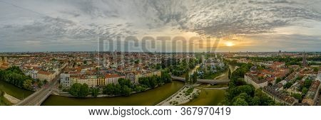 Munich From Above At Springtime, Panoramic View Over The Bavarian City At Sunrise. Overview Over Man