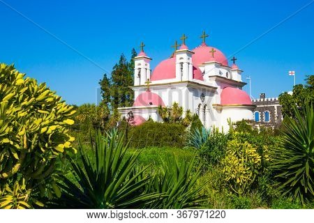 Place of worship and pilgrimage. Gorgeous green south park. Capernaum, Lake Tiberias. The Monastery of the Holy Twelve Apostles. Israel. The concept of religious pilgrimage