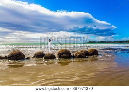 Moeraki Boulders is the group of large spherical boulders. The South Island of New Zealand. Pacific Ocean. Popular and scenic tourist attraction.  The concept of exotic and ecological tourism