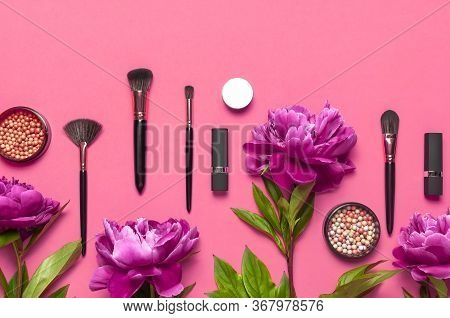 Professional Makeup Brushes, Powder, Eyeshadow, Blush, Lipstick Cream On Pink Background Flat Lay To