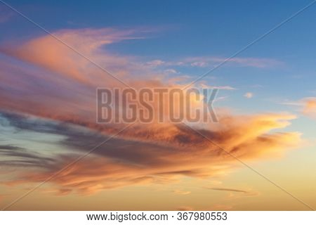 Spectacular Sunset With Soft Clouds In The Desert Sky