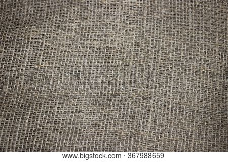 Background Of Burlap Hessian Sacking. Natural Textile Canvas