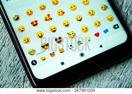 MOSCOW, RUSSIA - MAY 21, 2020: Facebook emoticons on the smartphone screen. Close-up.