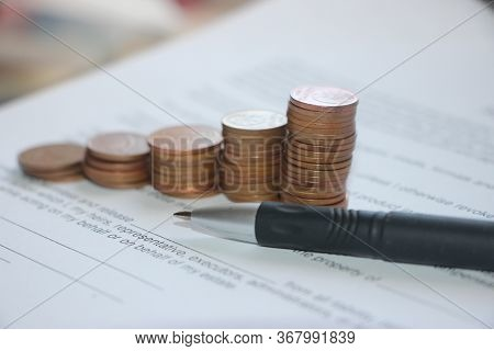 Pen And Contract Papers, Stack Of Coin Reminding Growing Diagram. Successfull Business Desicion Maki