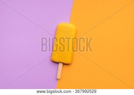 Vegan Orange Ice Cream On A Stick, On Seamless Duotone Background. Orange Sorbet Popsicle On A Purpl