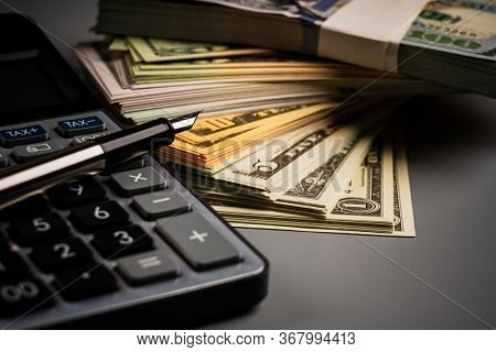 Success and got profit from business with many one hundred american dollar currency,money with calculator,