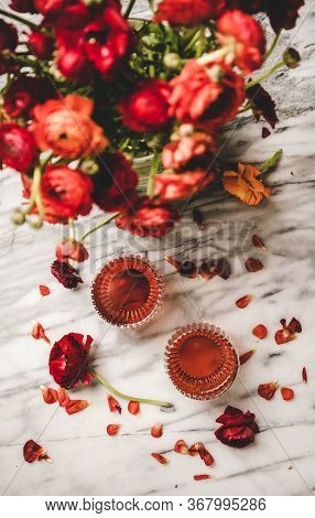 Rose Wine In Glasses And Red Spring Flowers And Petals
