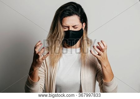 Stressed Woman Wearing Face Protection Mask. Mental Health Concept During The Covid-19 Pandemic.