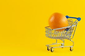 Shopping Cart With With Orange. Large Bright Oranges In The Cart For Shopping