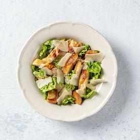 Caesar Salad. Grilled Chicken Breast Slices, Green Romaine Salad Leaves, Croutons And Parmesan Chees
