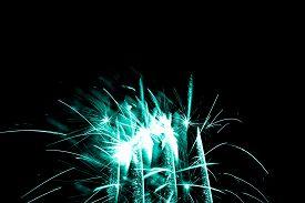 Luxury Fireworks Event Sky Show With Turquoise Glow Stars. Premium Entertainment Magic Star Firework