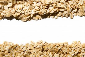 Close Up. Dry, Raw  Oatmeal Flakes ( Oat Flakes, Rolled Oats )  Frame On White Background