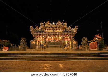 Brightly Lit Chinese Temple At Night