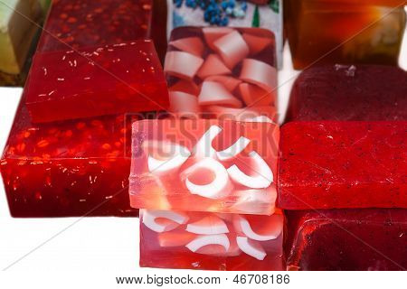 Red homemade soap bars in the market