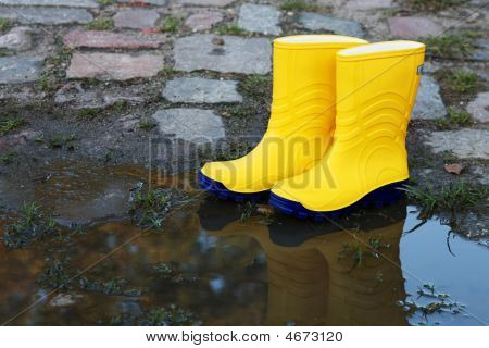Pair Of Yellow Rubber Boots